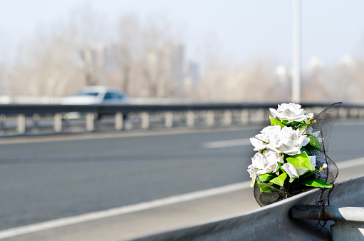 Flowers on the site of a traffic accident with a fatal outcome.