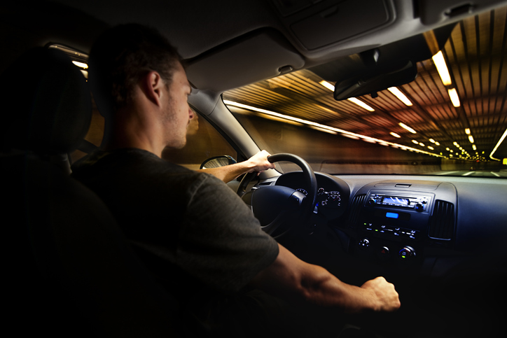 Teen driving over the speed limit in a tunnel